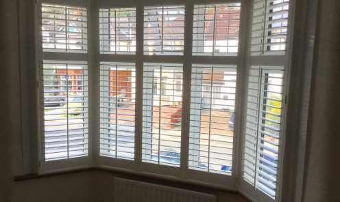 Bay window shutters in square bay