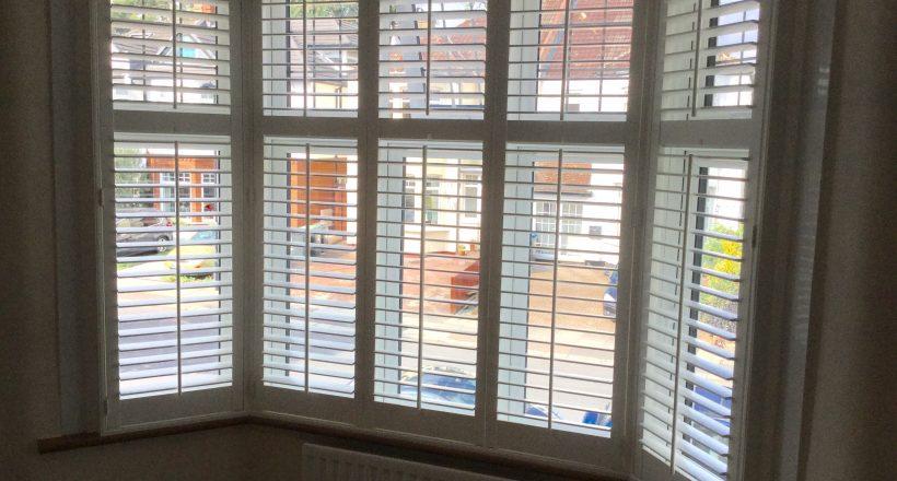 Bay window shutters in square bay