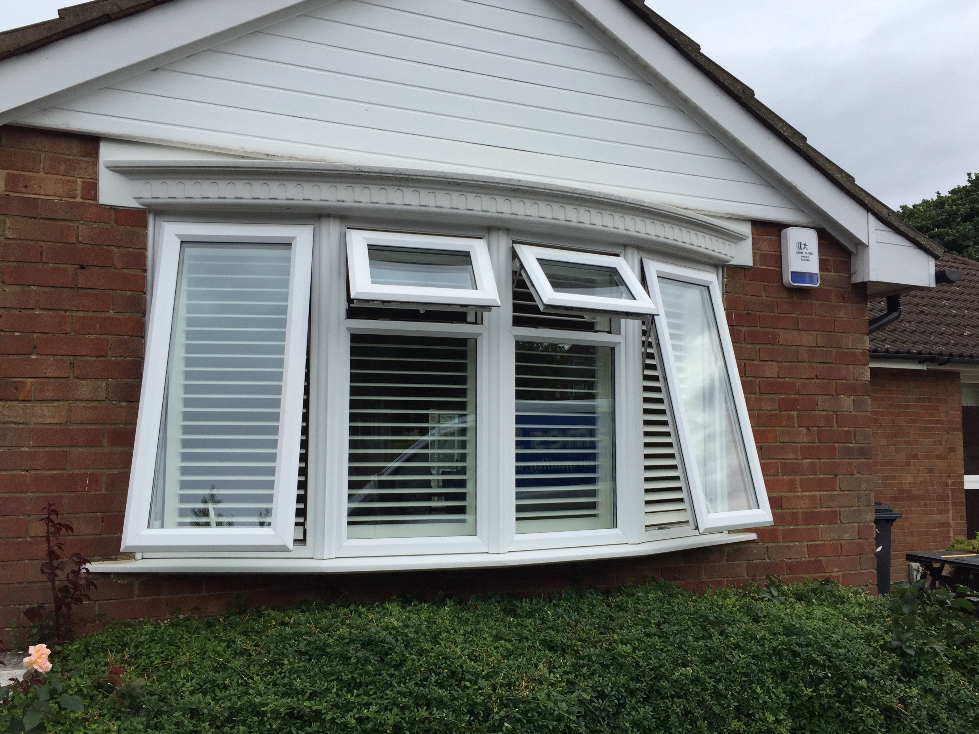 Outside bay windows - Bay Window Shutters Seens From Outside House With Two Large And Two Small Windows Open