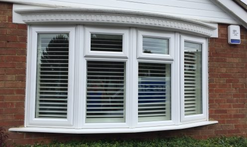 Bay window shutters seen from outside house