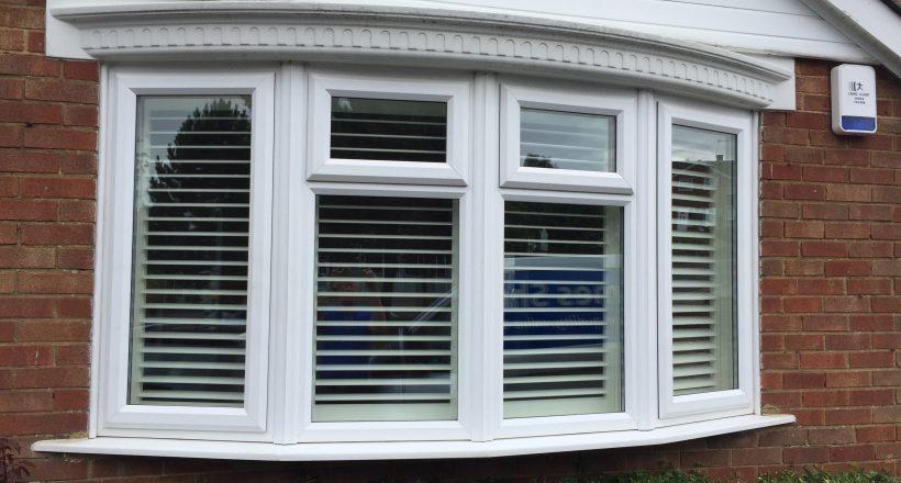 Bay window shutters seen from outside house