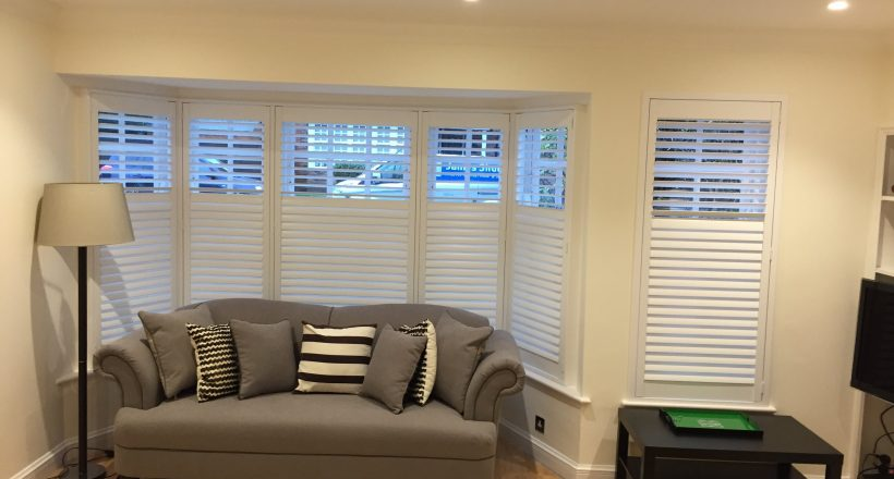 Bay Window Shutter with brown sofa