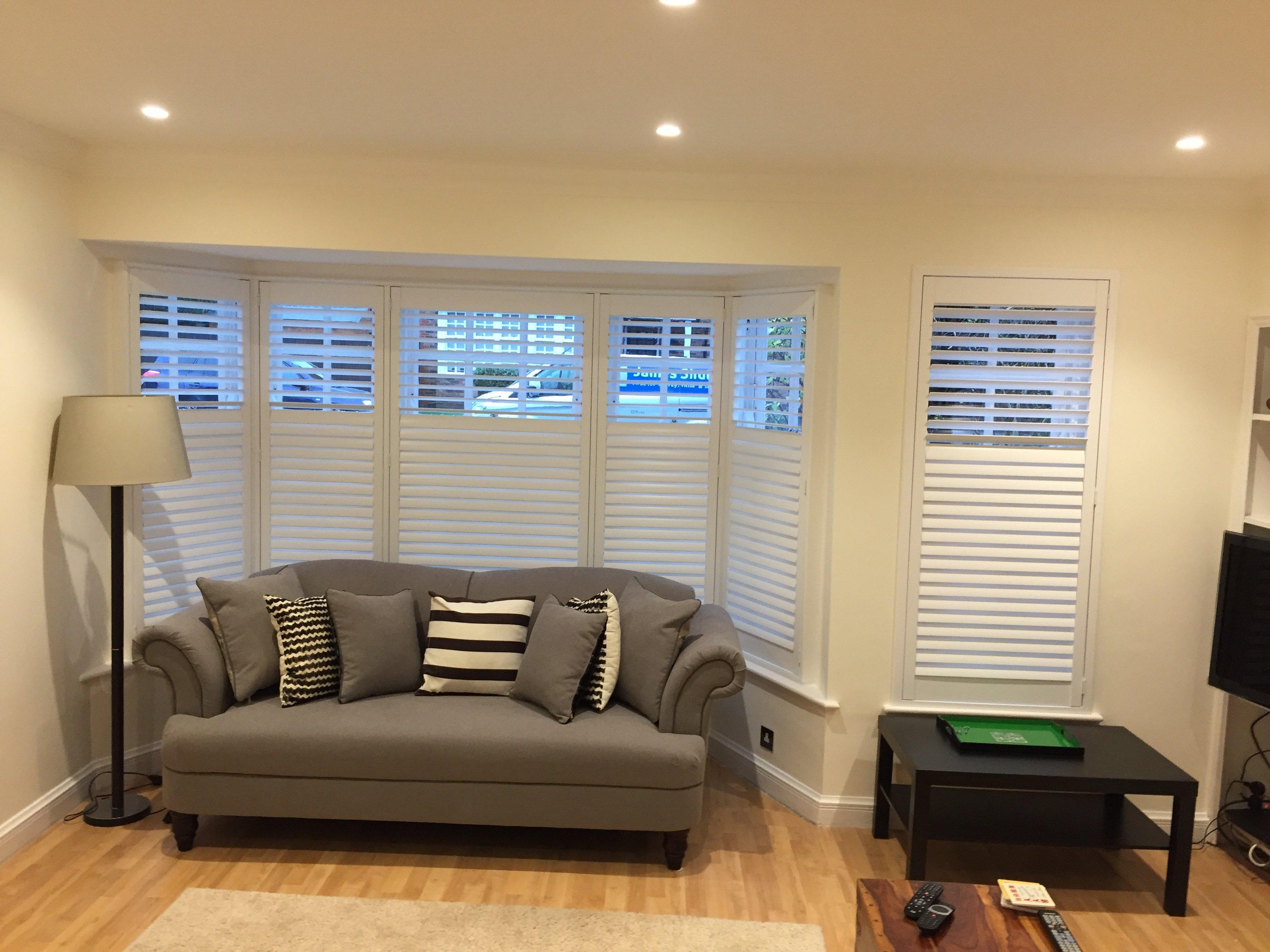 Bay Window Shutter with brown sofa