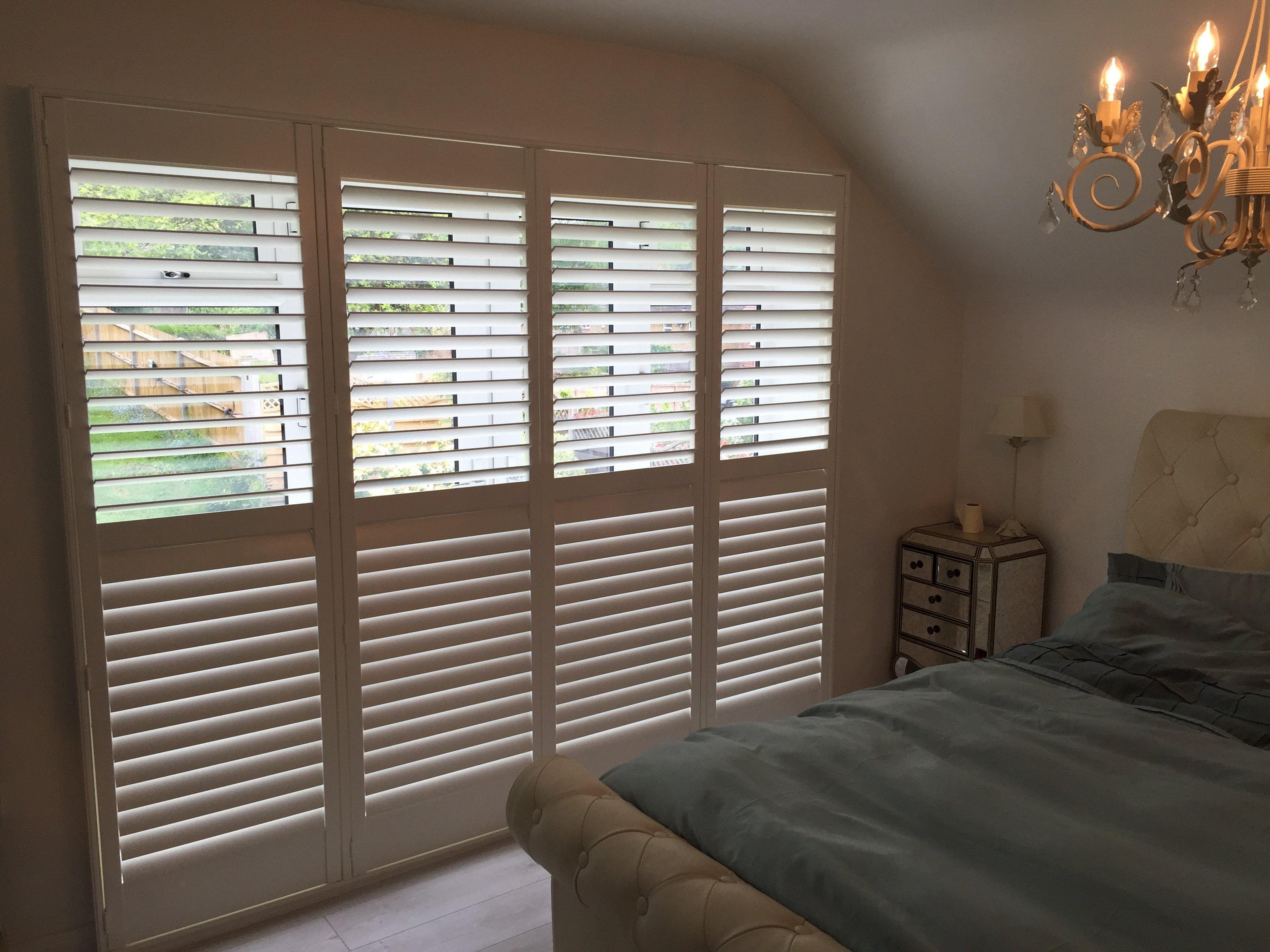 Fulll height Window Shutters along bedroom wall