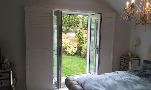 Full height window shutters on pation door leading into garden