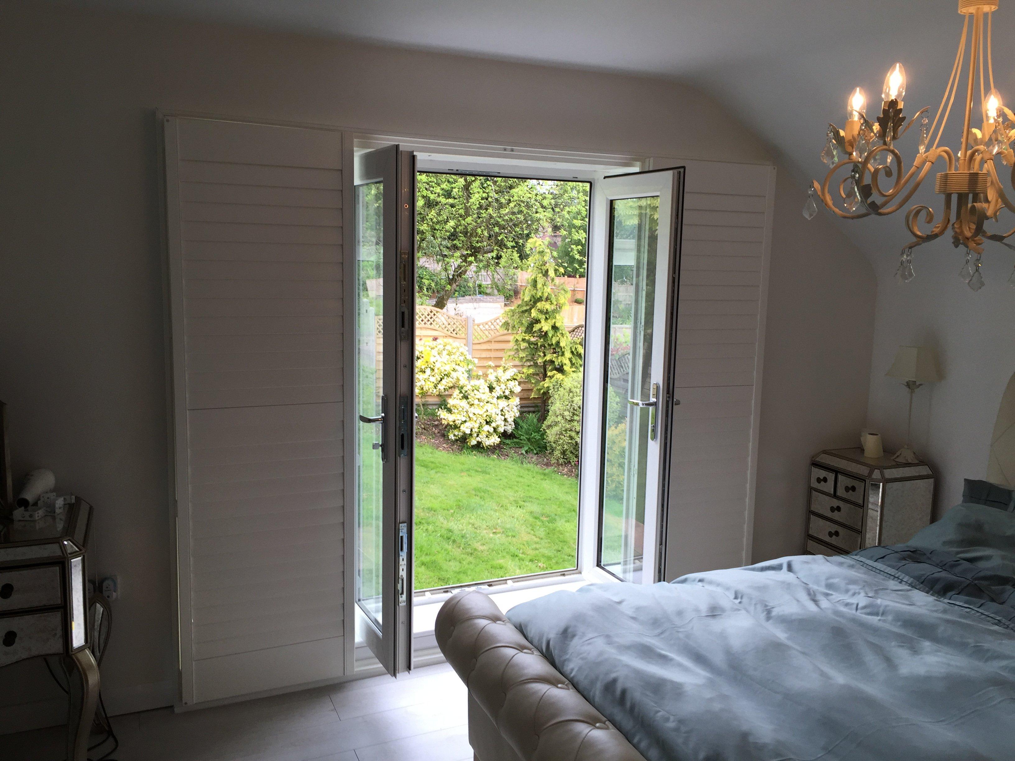 Full height window shutters on pation door leading into garden